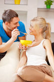 Happy couple at home. Bright picture of happy couple with muesli Royalty Free Stock Photography