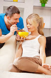 Happy couple at home. Bright picture of happy couple with muesli Stock Photography