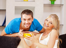 Happy couple at home. Bright picture of happy couple with muesli Royalty Free Stock Photo