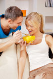 Happy couple at home. Bright picture of happy couple with muesli Stock Images