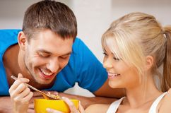 Happy couple at home. Bright picture of happy couple with muesli Stock Image
