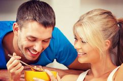 Happy couple at home. Bright picture of happy couple with muesli Royalty Free Stock Image