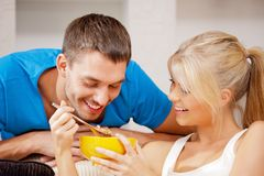 Happy couple at home. Bright picture of happy couple with muesli (focus on man Royalty Free Stock Images