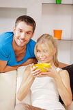 Happy couple at home. Bright picture of happy couple with muesli (focus on man Royalty Free Stock Image