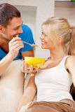 Happy couple at home. Bright picture of happy couple with muesli (focus on man Stock Photography