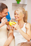 Happy couple at home. Bright picture of happy couple with muesli (focus on woman Stock Photography