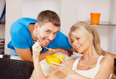 Happy couple at home. Bright picture of happy couple with muesli (focus on woman Royalty Free Stock Photography