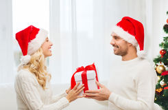Happy couple at home with christmas gift box Royalty Free Stock Images