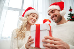 Happy couple at home with christmas gift box Royalty Free Stock Image