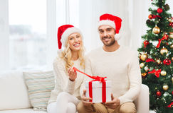 Happy couple at home with christmas gift box Royalty Free Stock Photos