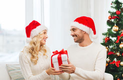 Happy couple at home with christmas gift box Royalty Free Stock Photo