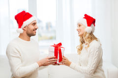 Happy couple at home with christmas gift box Stock Photo