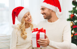 Happy couple at home with christmas gift box Stock Image