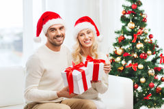 Happy couple at home with christmas gift boxes Royalty Free Stock Photo
