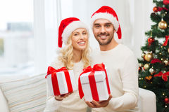 Happy couple at home with christmas gift boxes Stock Photo