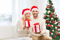 Happy couple at home with christmas gift boxes Stock Photography