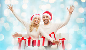 Happy couple at home with christmas gift boxes Stock Images