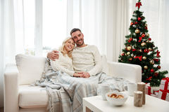 Happy couple at home with christmas tree Royalty Free Stock Images