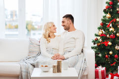 Happy couple at home with christmas tree Royalty Free Stock Photo