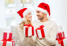 Happy couple at home exchanging christmas gifts Royalty Free Stock Image
