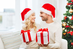 Happy couple at home exchanging christmas gifts Stock Photography