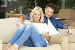 Happy couple at home Royalty Free Stock Photos