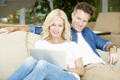 Happy couple at home Royalty Free Stock Image