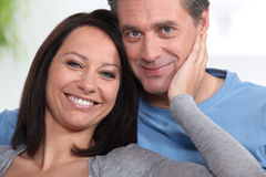 Happy couple at home Stock Image