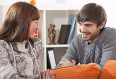 Happy couple at home talking stock images