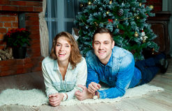Happy couple at home. Happy young couple kissing at home  at Christmas time Royalty Free Stock Photos