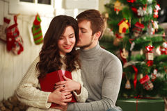 Happy couple in house on background of Christmas decorations Royalty Free Stock Image