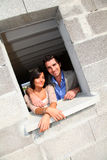 Happy couple in house under construction Stock Image