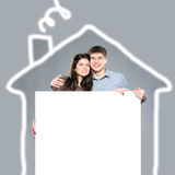 Happy couple in house Stock Images
