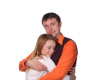Happy couple hugging. Happy young couple hugging each other in an affectionate pose on white background Stock Image