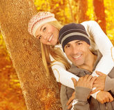 Happy couple hugging in autumn park Stock Images