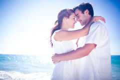 Happy couple hugging at the beach. On a sunny day Royalty Free Stock Photos