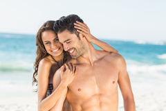 Happy couple hugging on the beach Royalty Free Stock Image