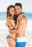 Happy couple hugging on the beach. On a sunny day Stock Image