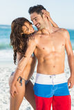Happy couple hugging on the beach Royalty Free Stock Photo