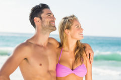 Happy couple hugging on the beach. On a sunny day Stock Photo