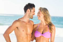 Happy couple hugging on the beach. On a sunny day Royalty Free Stock Image