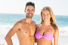 Happy couple hugging on the beach. On a sunny day Royalty Free Stock Photos
