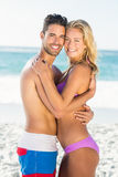 Happy couple hugging on the beach. On a sunny day Royalty Free Stock Images