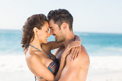Happy couple hugging on the beach. On a sunny day Stock Images