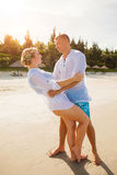 Happy couple hugging on the beach. Happy young couple hugging on the beach Royalty Free Stock Photo
