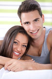 Happy couple hugging in bed Stock Photo