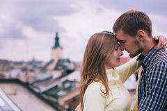 Happy couple hugging on the city roof Stock Photos