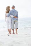 Happy couple hugging each other and looking at the sea Royalty Free Stock Photo