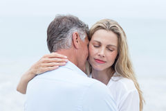 Happy couple hugging each other by the sea Royalty Free Stock Images