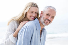 Happy couple hugging each other and smiling at camera Royalty Free Stock Images